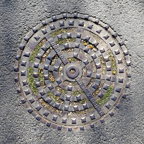 Manhole Cover, London - Cast iron raised squares in circular grid