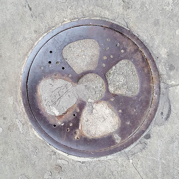 Manhole Cover, London - Cast iron with concrete propeller pattern