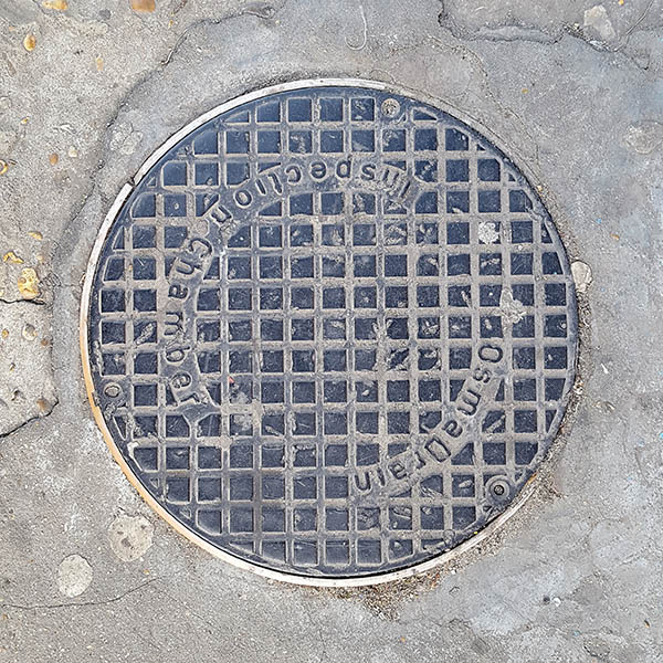Manhole Cover, London - Cast iron inscribed with Osma Drain Inspection Chamber - over raised square grid