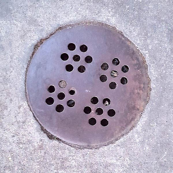 Manhole Cover, London - Cast iron with four circles of seven holes