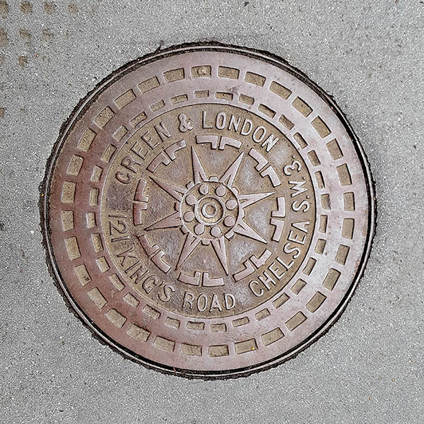 Manhole Cover, London - Cast iron with central star and text outer
