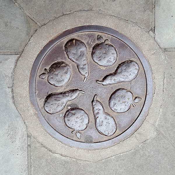 Manhole Cover, London - Cast iron with raised apples and pears