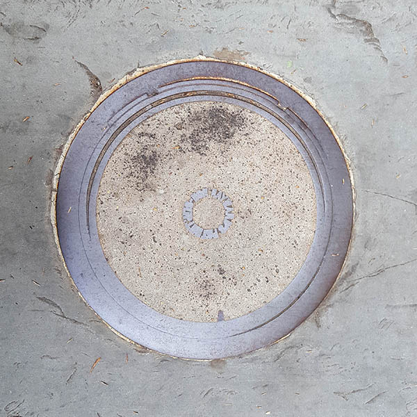 Manhole Cover, London - Cast iron with concrete inner
