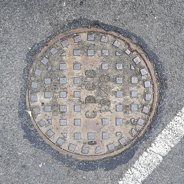 Manhole Cover, London - Cast iron with grid of small raised squares