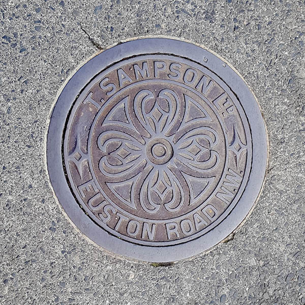 Manhole Cover, London - Cast iron with decorative centre and surrounding text