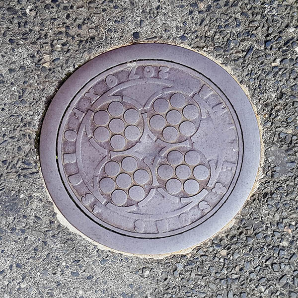 Manhole Cover, London - Cast iron with four circles and surrounding text