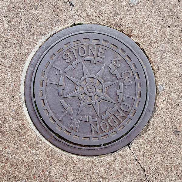 Manhole Cover, London - Cast iron with star centre and surrounding text