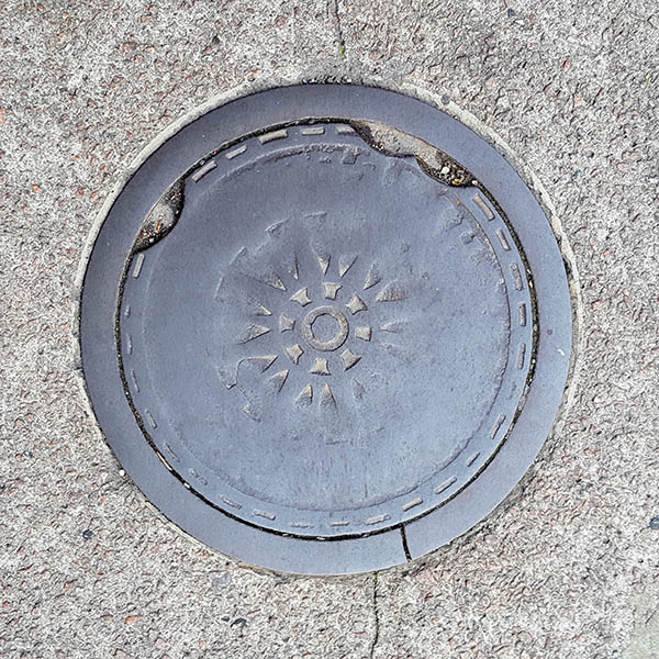 Manhole Cover, London - Cast iron with worn away pattern
