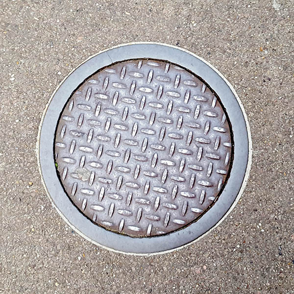 Manhole Cover, London - Cast iron with criss cross short line pattern