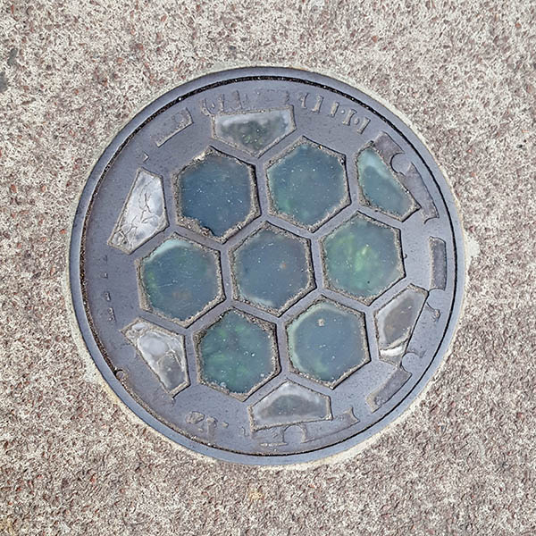 Manhole Cover, London - Cast iron with seven hexaganal glass inserts