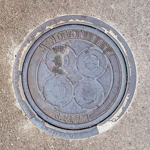 Manhole Cover, London - Cast iron with four circles and outer text