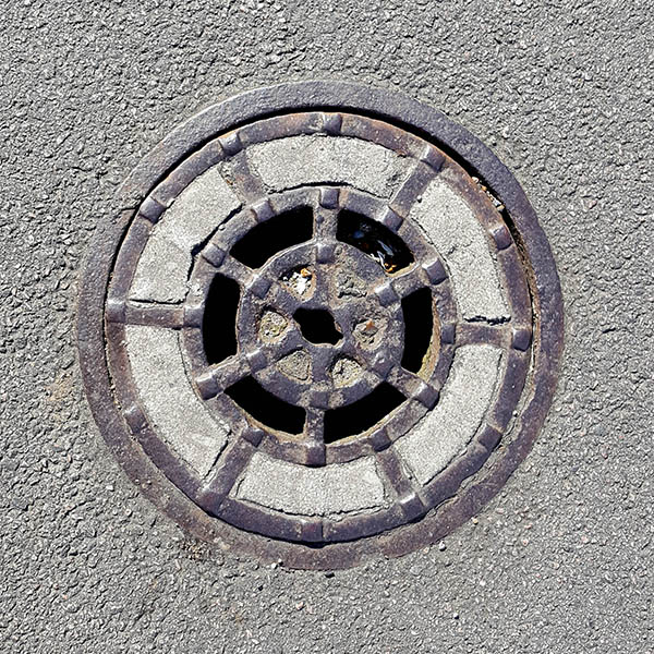 Manhole Cover, London - Cast iron with concrete