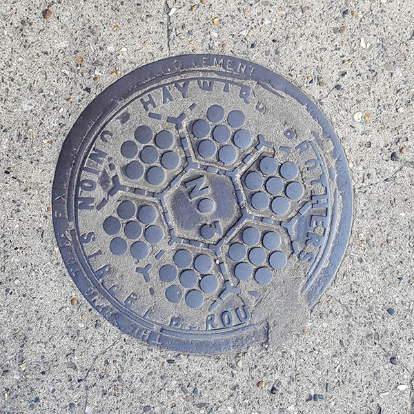 Manhole Cover, London - Cast iron with six hexaganals of seven holes