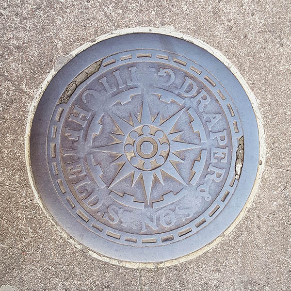 Manhole Cover, London - Cast iron with star centre and text outer