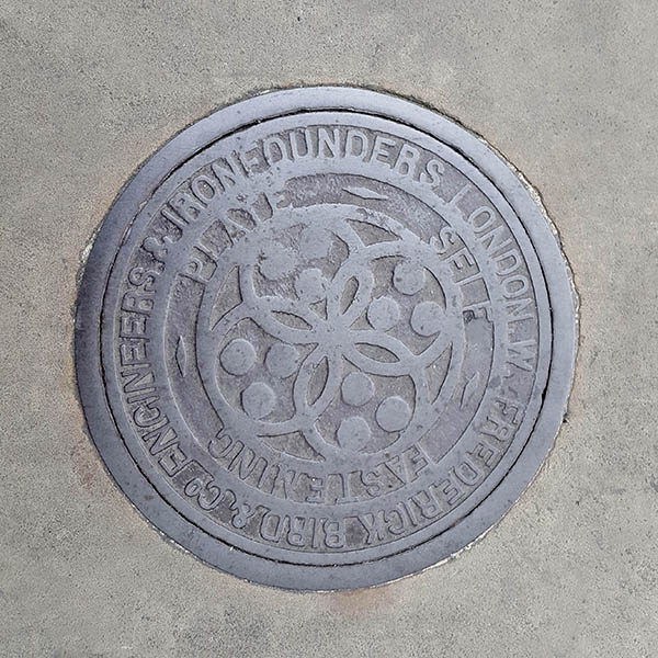 Manhole Cover, London - Cast iron with four intersecting circles and outer text