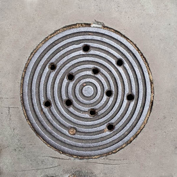 Manhole Cover, London - Cast iron rings with holes