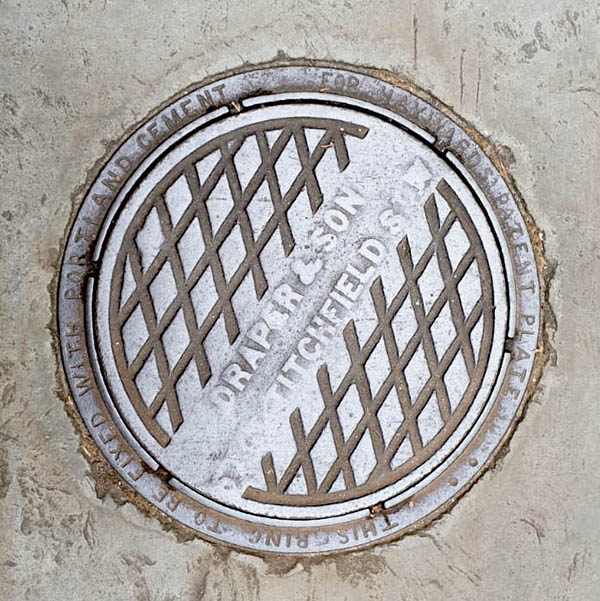 Manhole Cover, London - Cast iron criss cross pattern with diagonal text