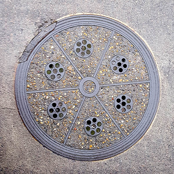Manhole cover, London - Cast iron segments filled with concrete