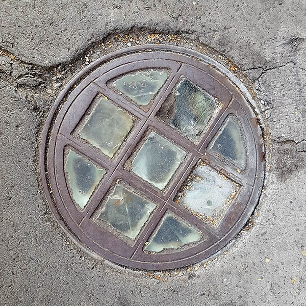 Manhole cover, London - Cast iron grid with glass inserts