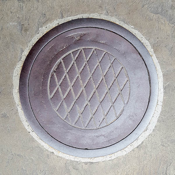 Manhole Cover, London - Cast iron surround with criss cross centre