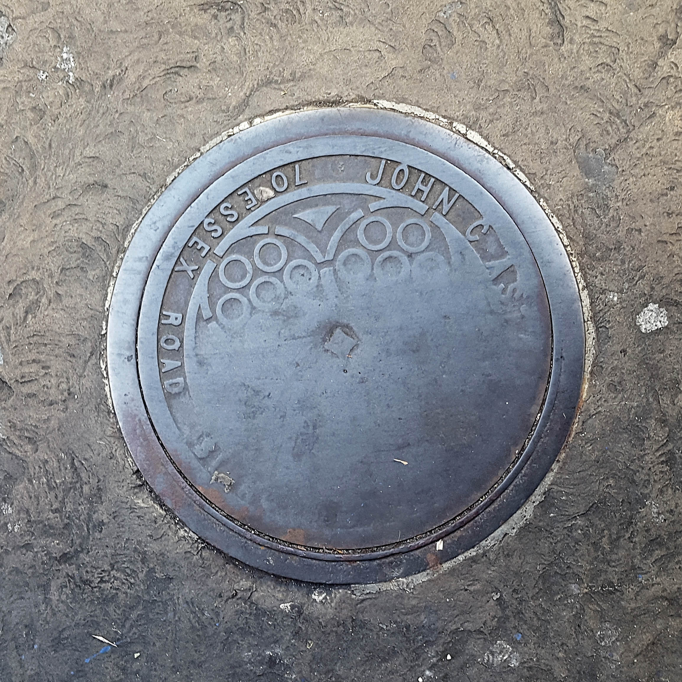Manhole Cover, London - Cast iron with decorative circular patterns half worn away with age
