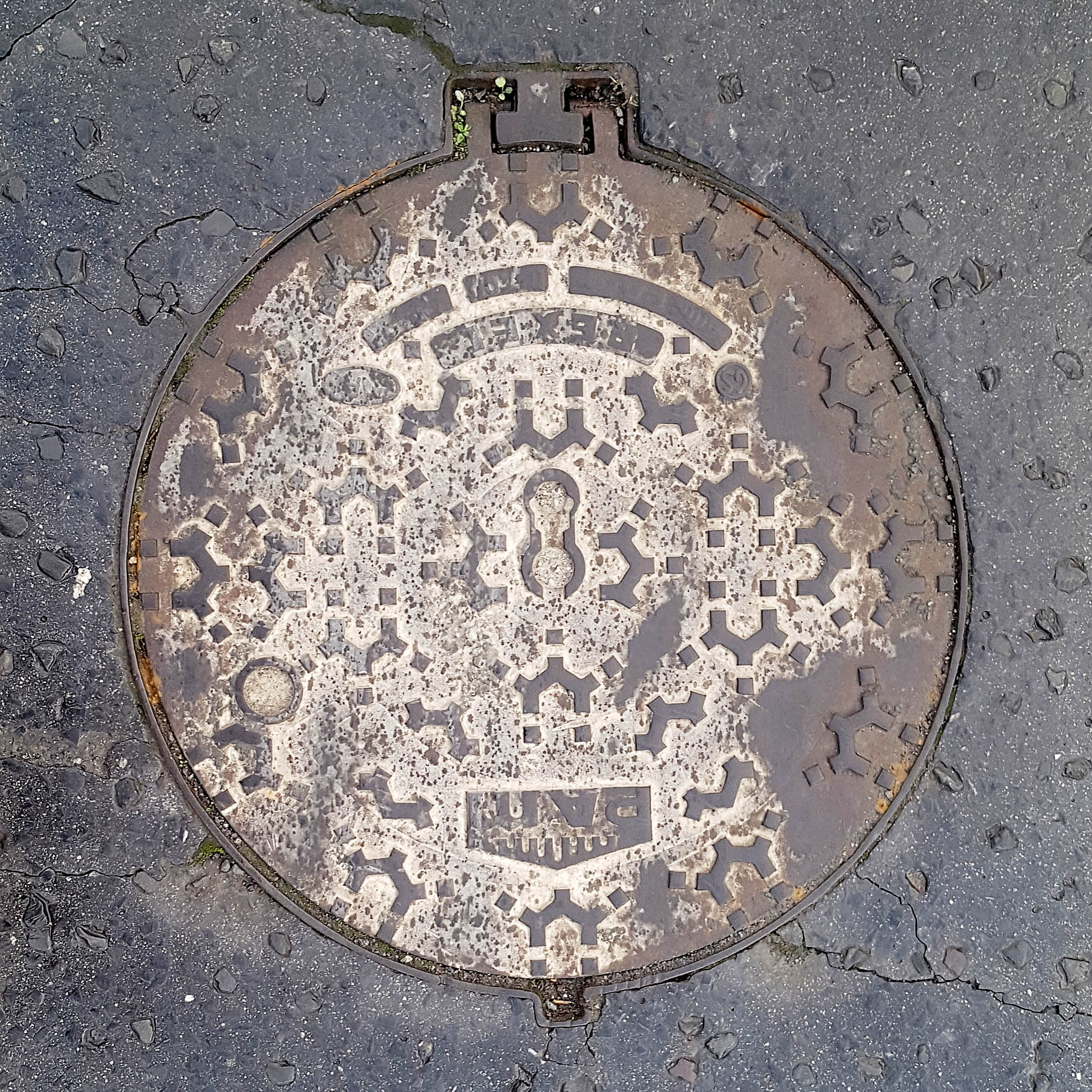 Manhole Cover, London - Cast iron with abstract symetrical pattern and integral hinge