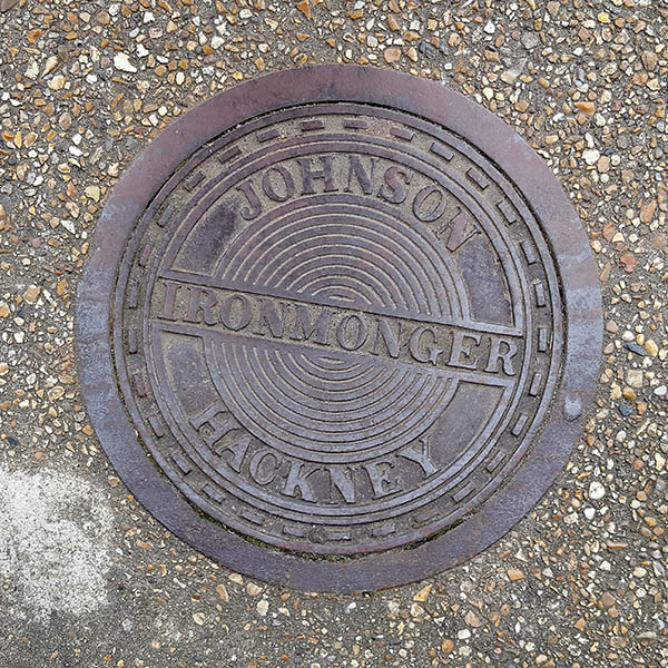 Manhole Cover, London - Cast iron with concentric circle pattern inscribed with Johnson Ironmonger Hackney