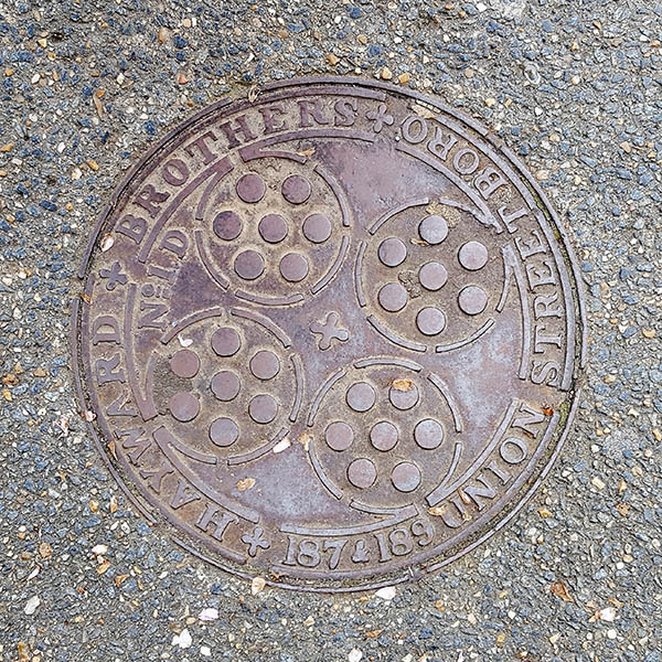 Manhole Cover, London - Cast iron surround inscribed with Hayward Brothers 187 & 189 Union Street Borough - Inner pattern of four circles surrounding smaller circles