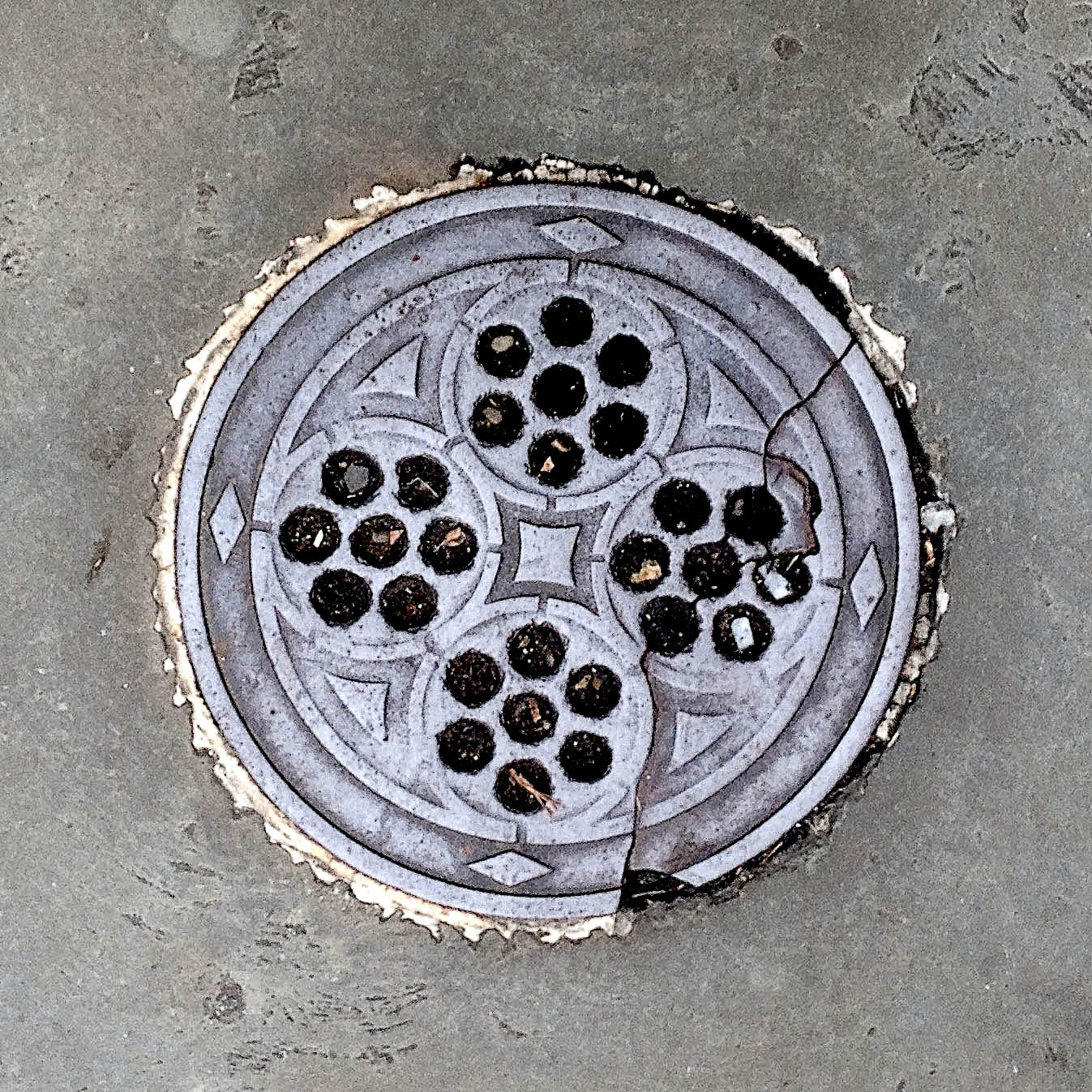 Manhole Cover, London - Cast iron with twenty eight holes arranged into four circular patterns