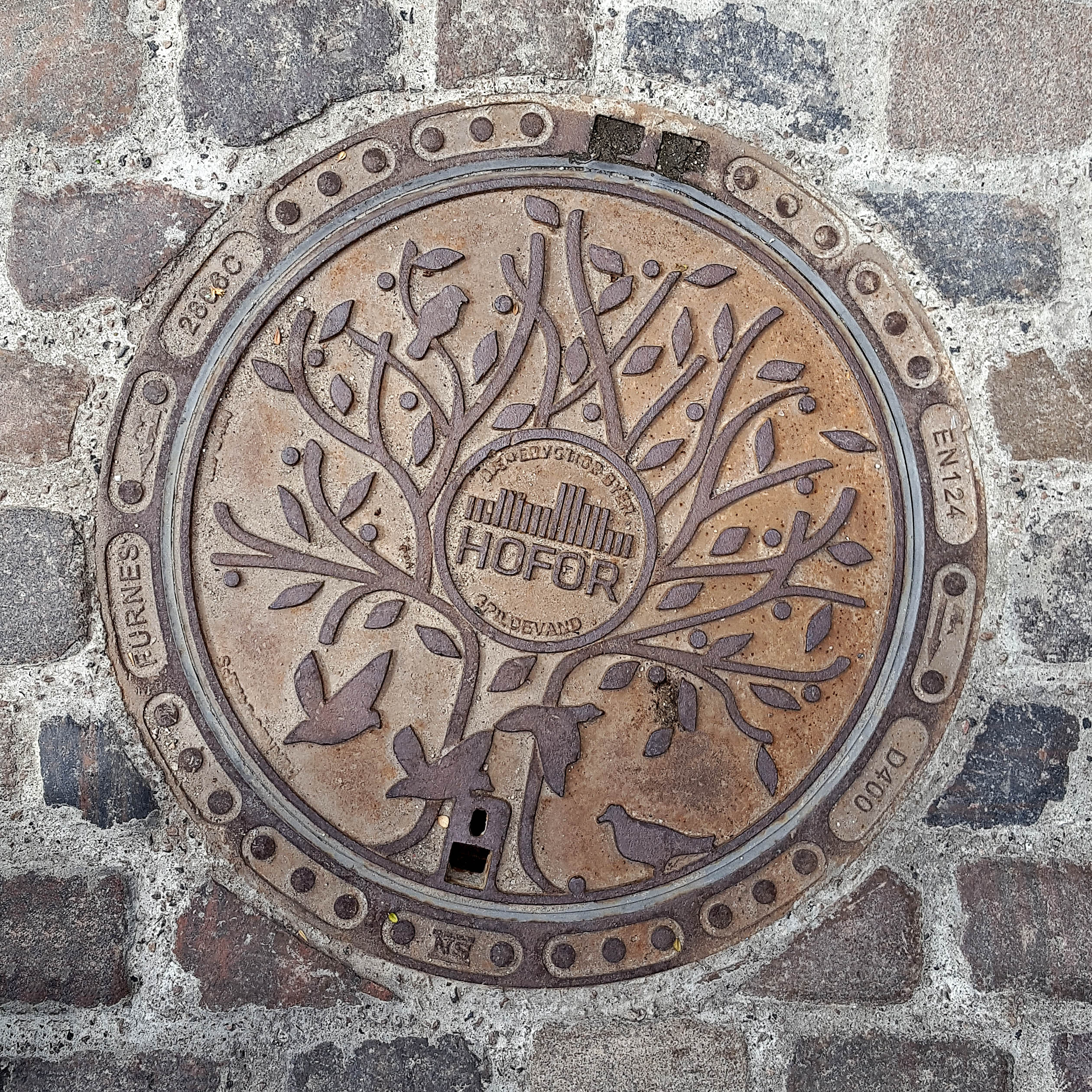 Manhole Cover, Copenhagen - Cast iron decorated with tree and birds