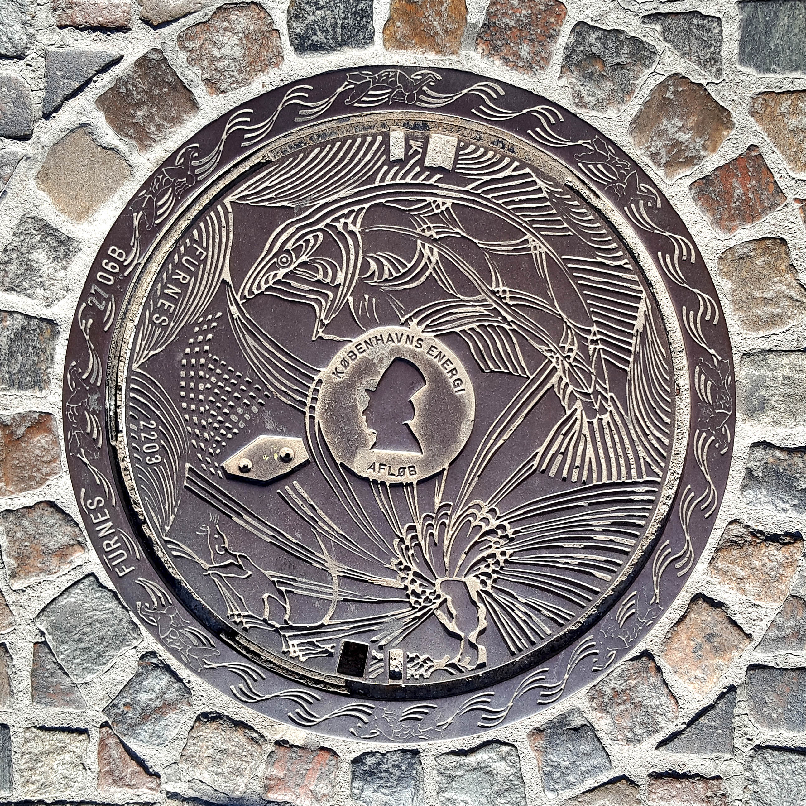 Manhole Cover, Copenhagen - Cast iron decorated with fish and peacock