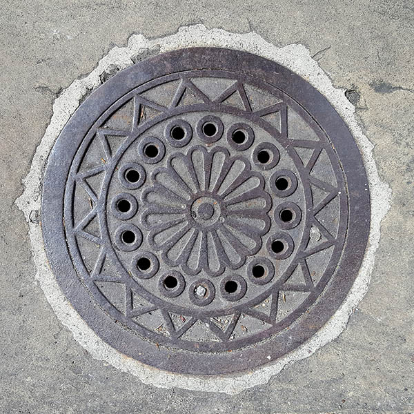 Manhole Cover, London - Cast iron with geometric floral pattern