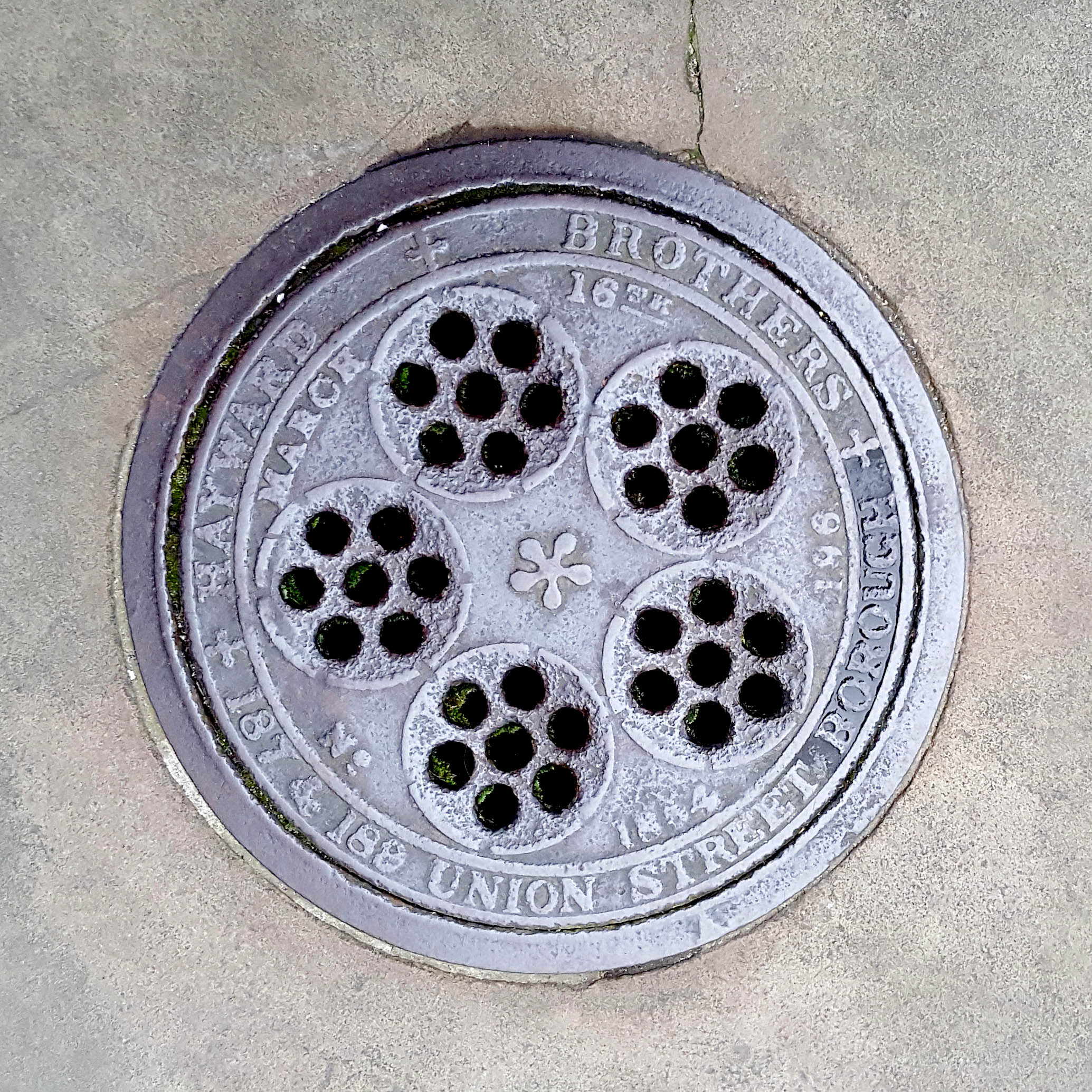 Manhole Cover, London - Cast iron with thirty five holes arranged into five circular patterns