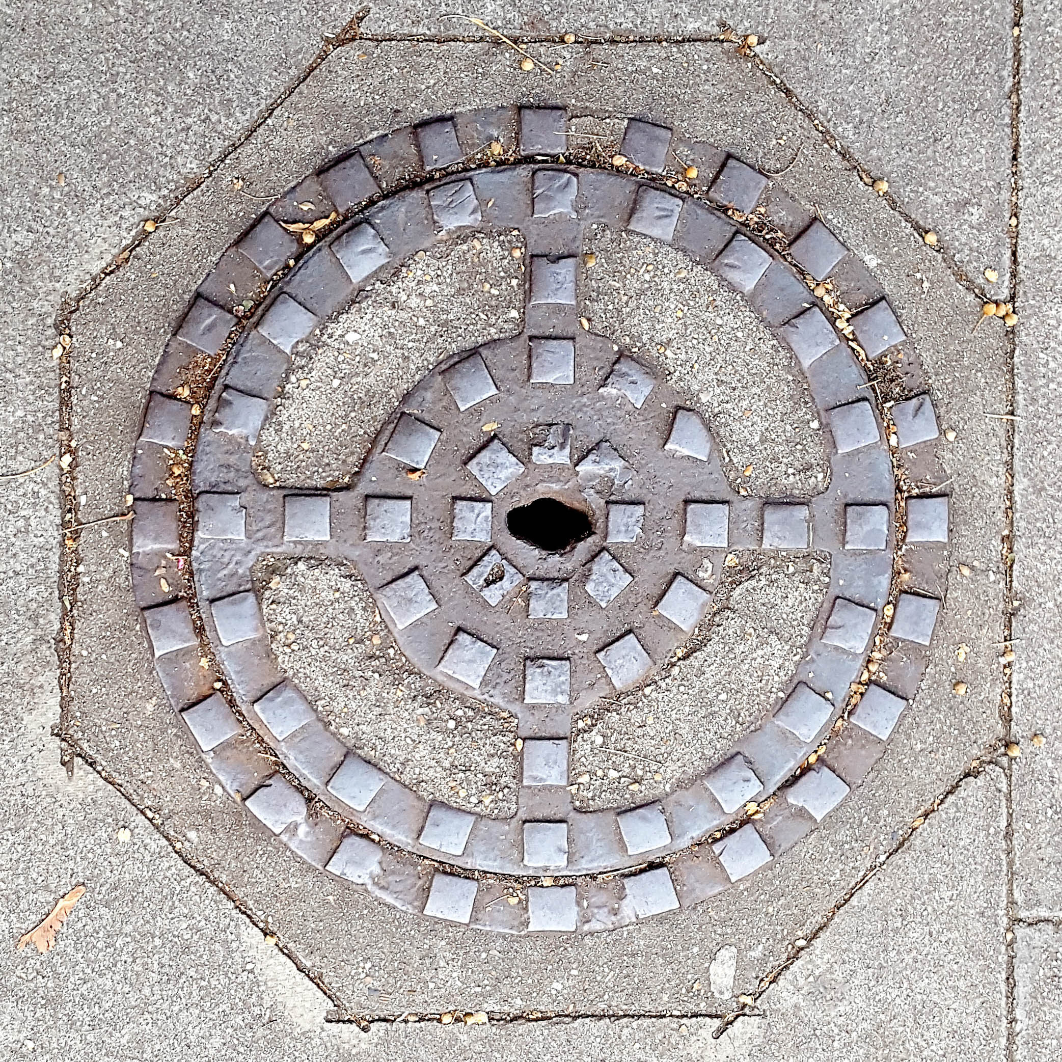Manhole Cover, London - Cast iron with raised squares and concrete sections