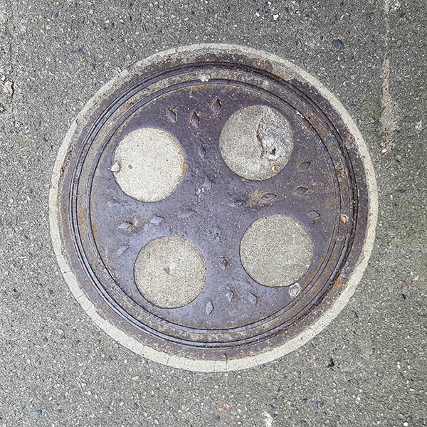 Manhole Cover, London - Cast iron with four concrete circular inserts