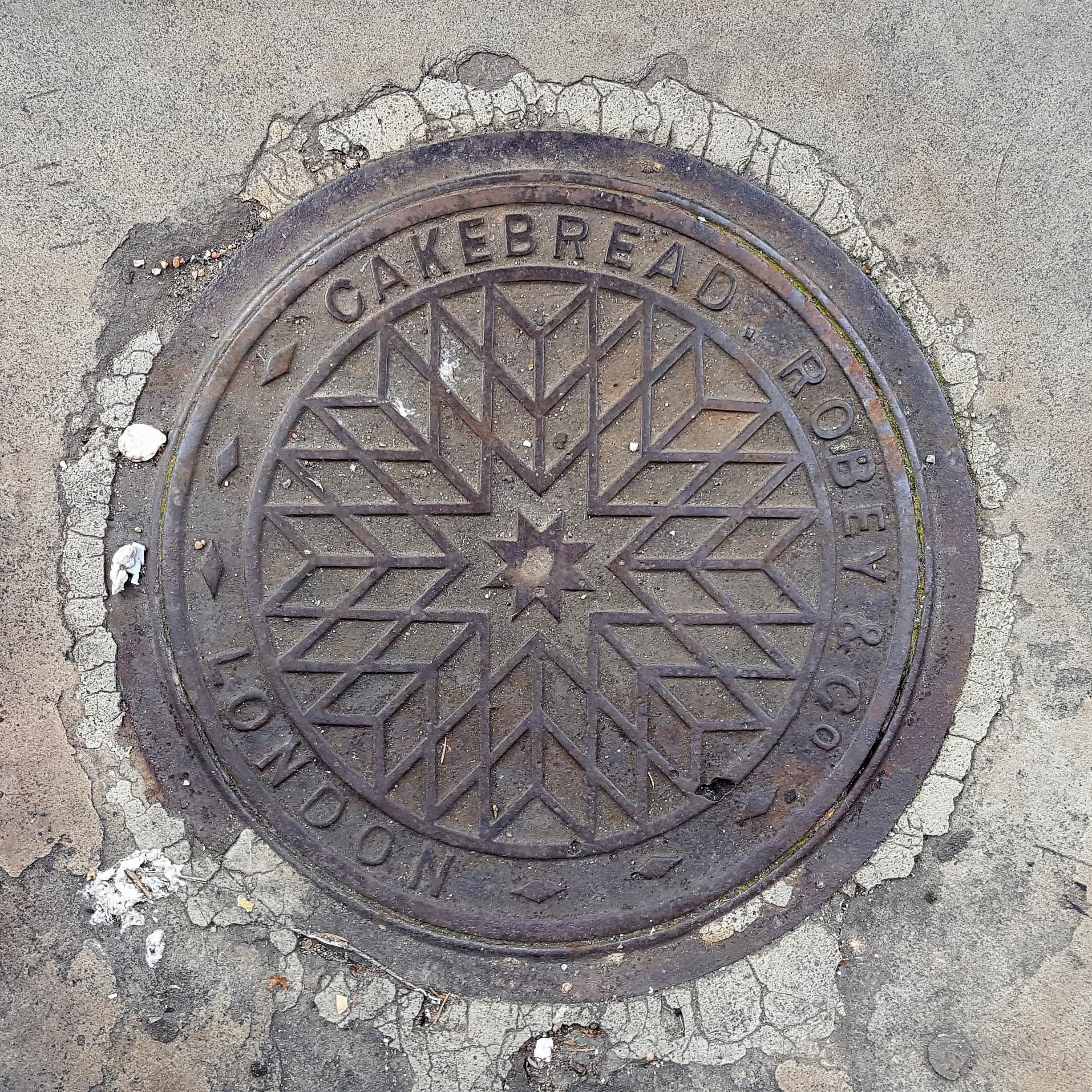 Manhole Cover, London - Cast iron with geometric star pattern - inscribed with Cakebread Robey & Co  London
