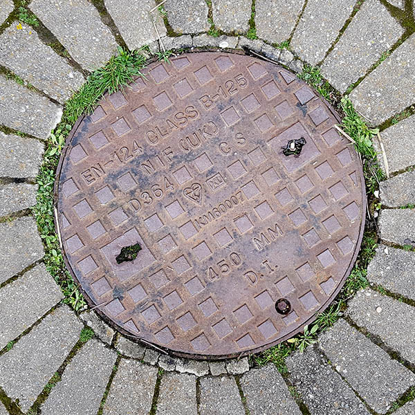 Manhole Cover, Essex - Cast iron with raised square pattern, inscribed with EN 124 CLASS B-125 NIF (UK) D364 CS KM 600007 450 MM D.I.