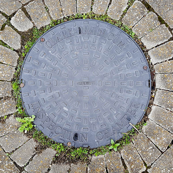 Manhole Cover, Essex - Cast iron with raised rectangle pattern, inscribed with CLARK-DRAIN.COM INSPECTION CHAMBER