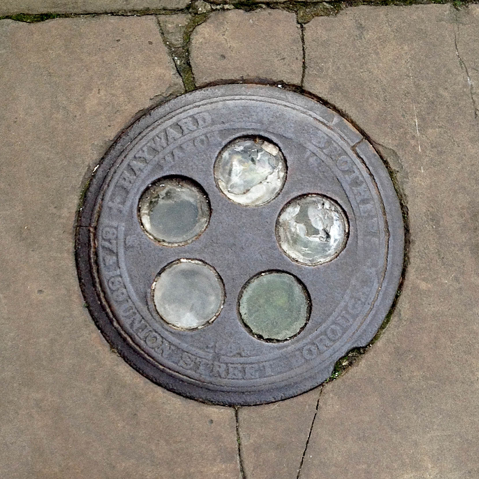 Manhole Cover, London - Cast iron - surround inscribed with Hayward Brothers 187 & 189 Union Street Borough - Inner, five glass circular inserts