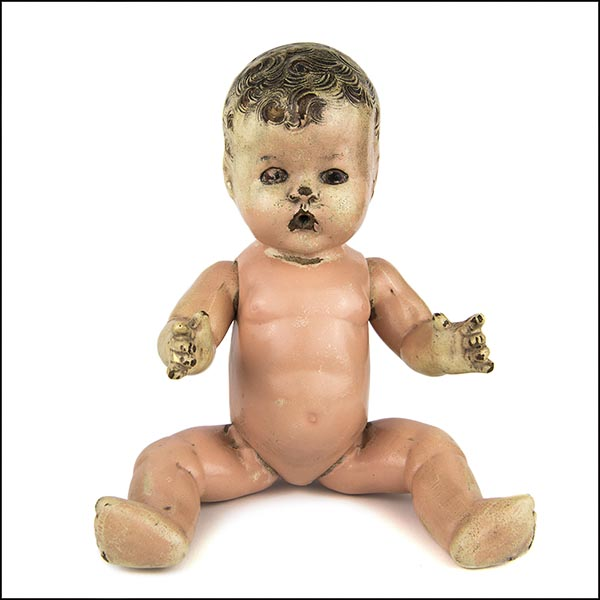Vintage composition doll with damaged face