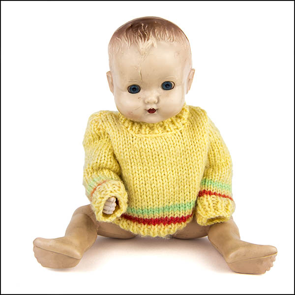 Vintage hard plastic doll with yellow knitted jumper